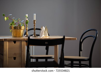 The sun is setting, creating a soft light on a Scandinavian kitchen table.