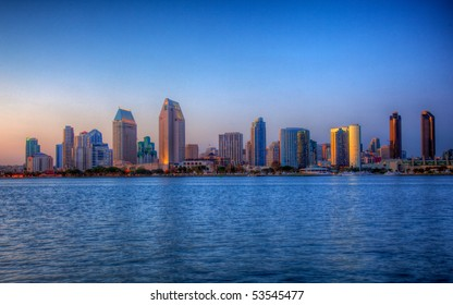 Sun setting lights up the buildings on San Diego seafront in HDR