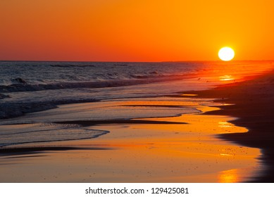 https://image.shutterstock.com/image-photo/sun-setting-on-beach-orange-260nw-129425081.jpg