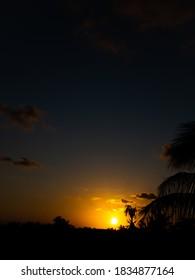 The sun setting on the Horizon
