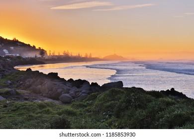 Sun setting on Sumner Beach, Christchurch, New Zealand