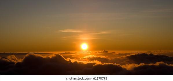 The sun is setting on top of Haleakala Volcano. Maui, Hawaii, Haleakala National Park.