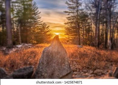 Sun setting on the winter solstice stone at America's Stonehenge