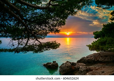 sun setting over the Adriatic sea in Brela