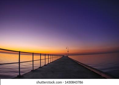 Sun setting over Dromana pier