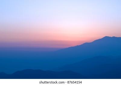 sun setting over the foggy san bernardino mountains,california,winter 2009.