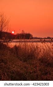 Sun setting over Jubilee River near Eton Dorney.