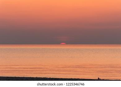 The sun setting over lake ontario from Port Dalhousie Ontario