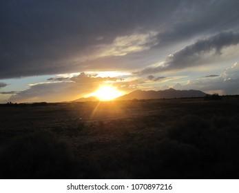 Sun setting over the Maricopa Mountains