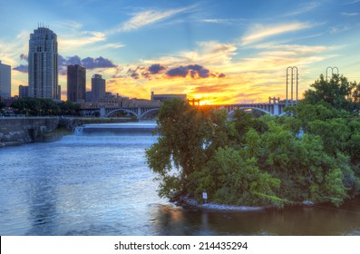 Sun is setting over Mississippi River, in Minneapolis.