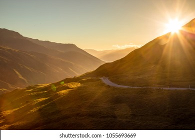 The sun setting over a mountain range in Queenstown