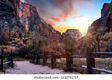 The sun setting over the mountains on a trail in Zion National Park, Springdale, Utah, USA.