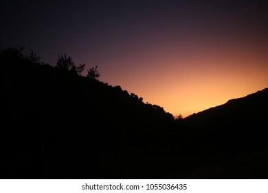 Sun setting over the mountains of Ramallah, Palestine.
