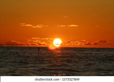 the sun setting over the ocean