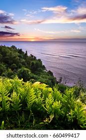 Sun Setting over the Pacific Ocean in Princeville Kauai, Hawaii