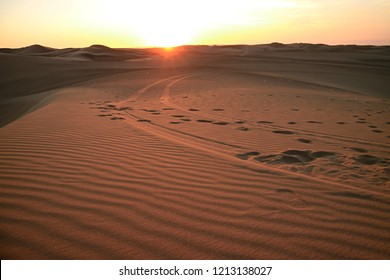 The sun setting over the sand dune of Huacachina desert, Ica region, Peru, South America