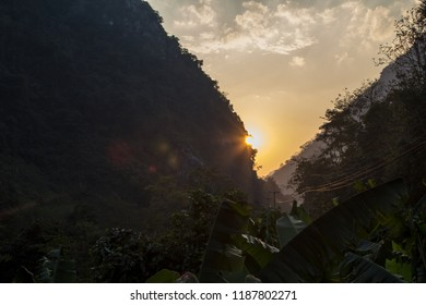 The sun setting in a remote jungle valley of the people's republic Laos