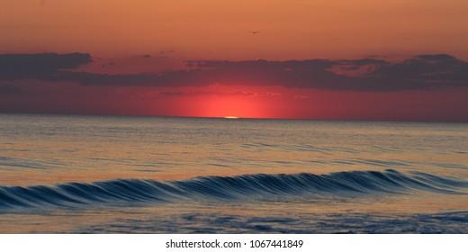Sun setting at St Andrews St Park, Panama City Beach, Fl