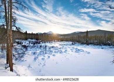 Sun setting in the Winter over Byers Peak, Winter Park, Colorado