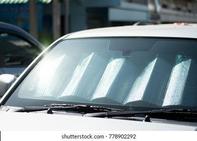 sun shade or sun reflector on the windshield the car Protection of the car in a parking. have the light from the sun shines to the windshield