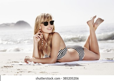 Sun and shades for bikini girl at beach