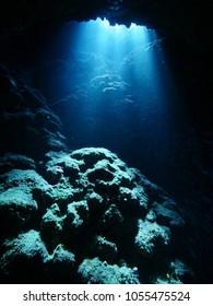 sun shine sun rays on rocks underwater