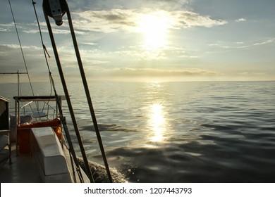 the sun shines on the ocean horizon
