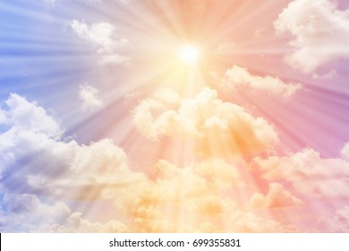 The sun shines on the pastel sky for background - Shutterstock ID 699355831