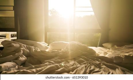 The sun shines through window in the morning.
