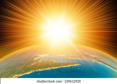The Sun shining above the planet Earth. Aerial  view from space