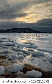 Sun shining off the frozen bay and ice pieces along the Apex trail near Iqaluit, Nunavut