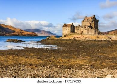 Sun shining on Eilean Donan Castle in the Scottish Highlands