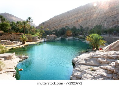 Sun shining on the emerald water pools of Wadi Bani Khalid, an oasis in Oman, Arabia