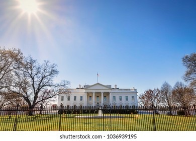 The sun shining on the front lawn of the White House in Washington, DC.