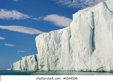 Sun shining on glacial cliff side.  Horizontally framed shot.