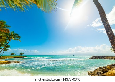 Sun shining over Bas du Fort beach in Guadeloupe, French west indies. Lesser Antilles, Caribbean sea