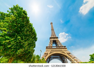 Sun shining over Effel tower in Paris, France