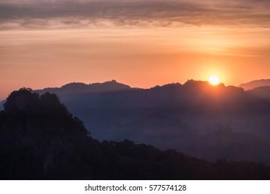 Sun shining over mountain in morning