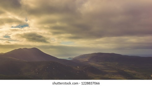 sun shining through the clouds at Mount Oberon Summit at sunset, Wilsons Promontory National park