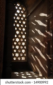 The sun shining through the ornately carved stone window inside the Alai Darwaza, built in 1311 as the southern entrance to the Qutab Minar, one of the largest standing stone minarets in the world.