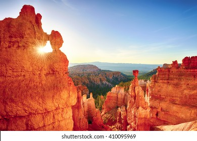Sun is shining through the rock window in the early morning. Bryce Canyon National Park, Utah, USA.