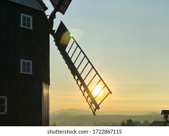 Sun shining through the sail of the windmill in Kottmarsdorf, Upper Lusatia, Saxony, Germany