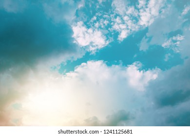 Sun shining in turquoise blue sky. For background and wallpaper