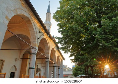 Sun star on the internal courtyard of Gazi Husrev Begova Mosque, with columns and the minaret in the background,  Sarajevo, Bosnia and Herzegovina