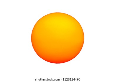 The Sun with sunspots visible as dark spots Isolated over white background
