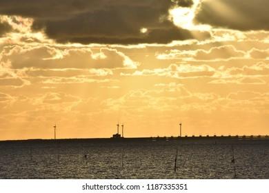 Sun through cloubs above Oosterschelde