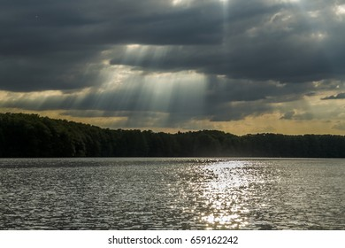 sun through clouds and pond