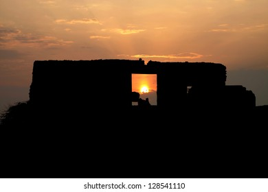 Sun through the door of the ancient ruin village
