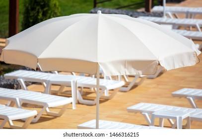 Sun umbrella on the beach .