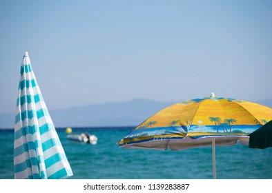 sun umbrella, sea,and boat